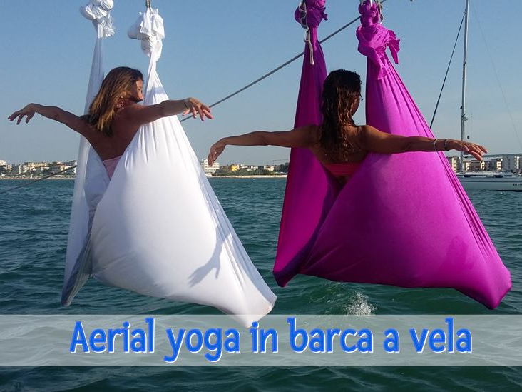 Olisticmap - WORKOUT IN BARCA A VELA DI AERIAL YOGA
